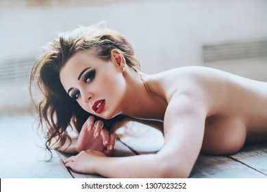 Young sexy topless nude woman portrait in soft white sunny colors