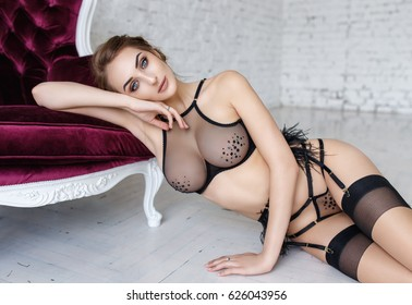 Young sexy woman in a beautiful black lingerie