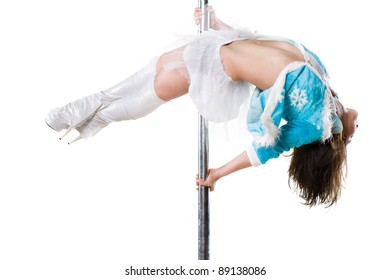 Young sexy woman in christmas dress exercise pole dance against a white background