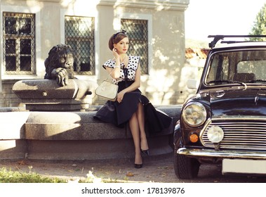 Young and sexy woman with her car - retro style image.
