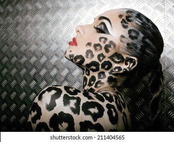 young  sexy woman with leopard make up all over body, cat bodyart