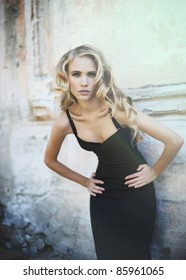 young sexy woman in a little black dress