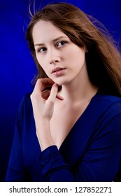 Young sexy woman on a blue background