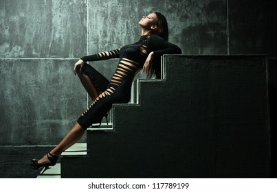 Young sexy woman on wall background.