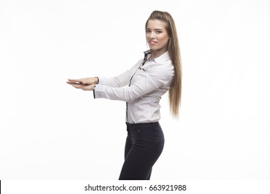 Young sexy woman portrait of a confident businesswoman showing dimension on a gray background. Ideal for banners, registration forms, presentation, landings, presenting concept..
