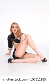 Young sexy woman in a provocative pose with high heel shoes