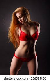 Young sexy woman in red lingerie portrait.