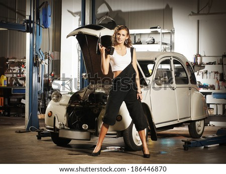 car Vintage fixing sexy woman
