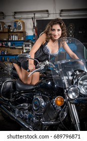 Young sexy woman sitting on motorcycle. Beautiful girl on a motorcycle.