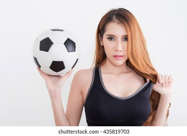 Young sexy woman in sports ware with soccer ball isolated on white background