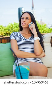 young sexy woman talking on phone in cafe