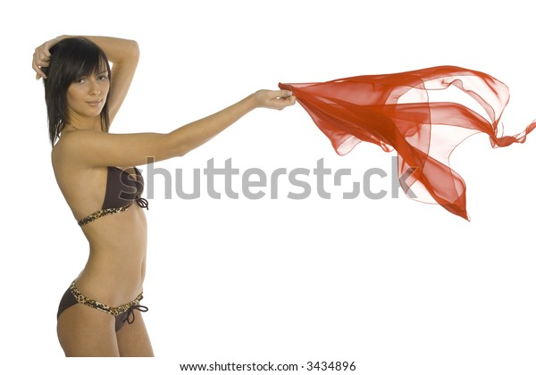 Young, sexy woman wearing bikini. Holding shawl in one hand. Isolated on white in studio. Looking at camera, side view
