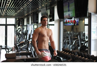 Young Shirtless Handsome Muscular Man Admiring - Portrait Of A Physically Fit Muscular Young Man Without A Shirt In A Gym