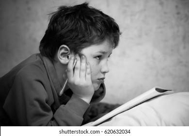 Young shoolboy preparing his homework
