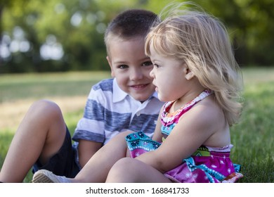 Young siblings enjoying childhood in park