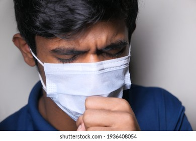 young sick man coughing and sneezes
