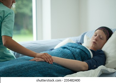 Young sick woman sleeping in her bed