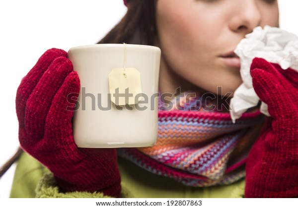 Young Sick Woman with Tissue Holding Cup with Blank Tea Bag Hanging.