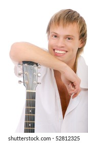 Young singer leans elbows on guitar and laughs