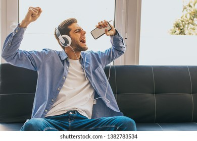 young singing with phone and headphones