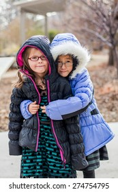 Young sisters playing outside together at a park in Reno, Nevada, USA.