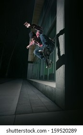 Young Skateboarder doing a Wallie on a wall
