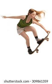 A young skateboarder flying through the air, isolated on white background.