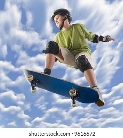 Young skateboarder make a jump on skateboard. Unusual angle view - directly below.