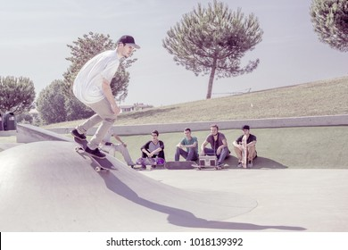 young skateboarder practicing in skate park. street style, youth culture and extreme sports concept.