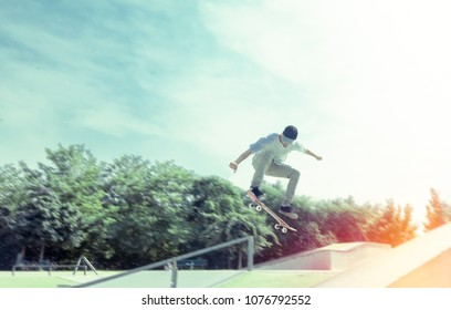 young skateboarder practicing in skate park. motion blur in background.