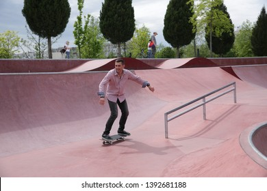 young skateboarder practicing at skatepark