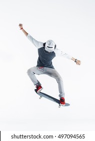 Young skater doing a jumping trick 'ollie' on a skateboard.