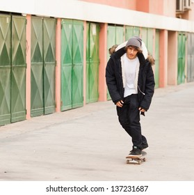 young skater rolling down the street