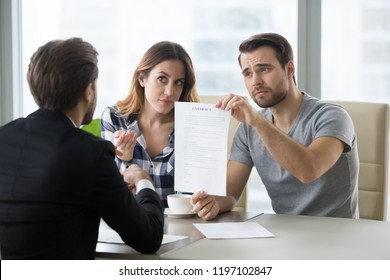 Young skeptic couple meet lawyer dissatisfied with terms of suspicious contract, refuse to sign. Family buying renting house, apartment, real estate, taking bank loan. Displeased customer ask question