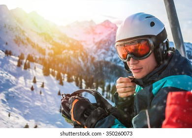 Young skier sitting in cabin on ski resort. Alps, Austria Beautiful winter landscape.