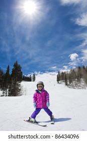 Young Skier skiing down a perfect ski run