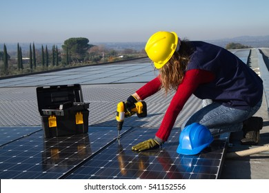 young skilled girl fitting a photovoltaic plant