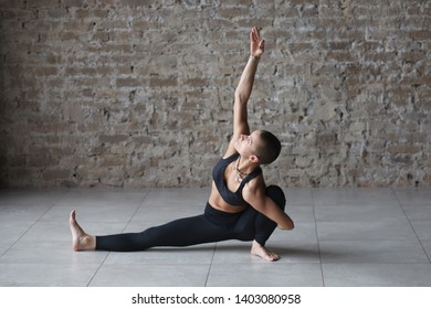 young skinhead woman doing yoga exercise - marichyasana indoor