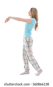 young sleepwalking woman in pajamas isolated on white background