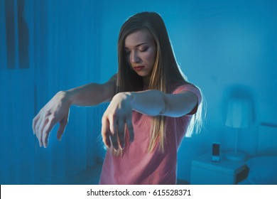 Young sleepy woman suffering from somnambulism at home