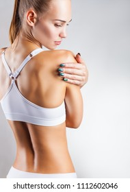Young slender woman in a sports bra. View from the back