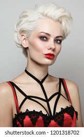 Young slim beautiful blonde woman in sexy lingerie
