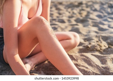 young slim beautiful woman in pink bikini on tropical beach. Portrait of happy young woman smiling at sea. Girl in swimwear enjoying and walking on beach.