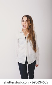 young slim girl in autumn coat. office worker in a shirt and trousers. posing in Studio on white background paper. Wallpapers for your desktop. long hair and clean skin