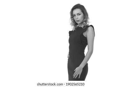 young slim girl in a black dress on a white background