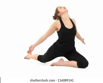 young slim girl in difficult yoga pose, full frontal view, dressed in black, on white background