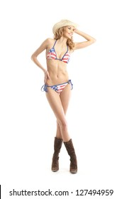 Young, slim, healthy and beautiful woman in swimsuit over the white background