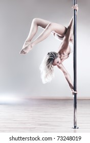 Young slim pole dance woman. Bright white colors.