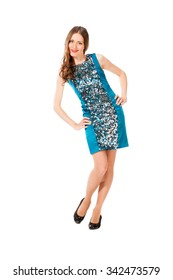 Young slim pretty woman in blue dress with sequins posing isolated on white background