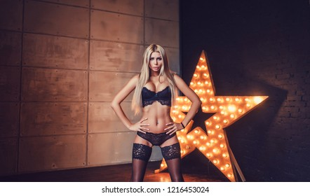 Young slim sexy woman in black lingerie portrait
